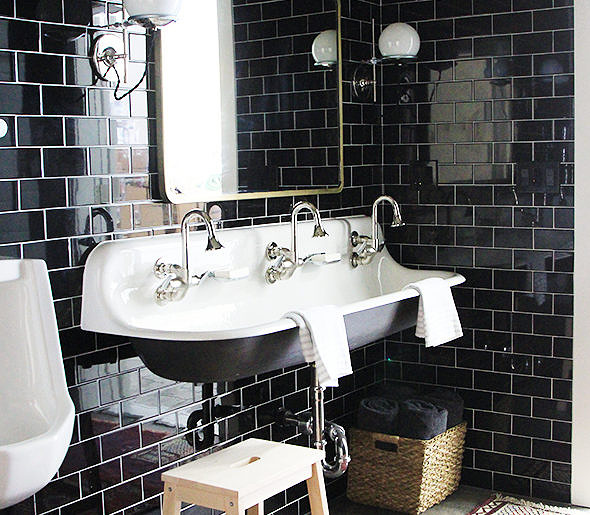 designing this bathroom for a family with three little boys jenny added in concrete floors a trough sink and a urinal too at the request